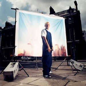 Eminem in the City Posing in front of a city screen