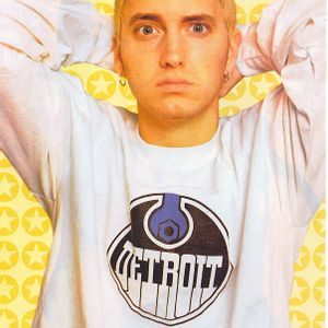 Eminem posing with a yellow background
