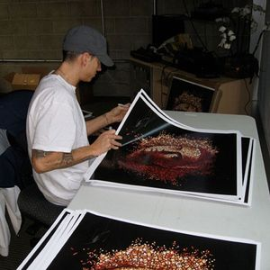 Eminem signing autographs on Relapse posters